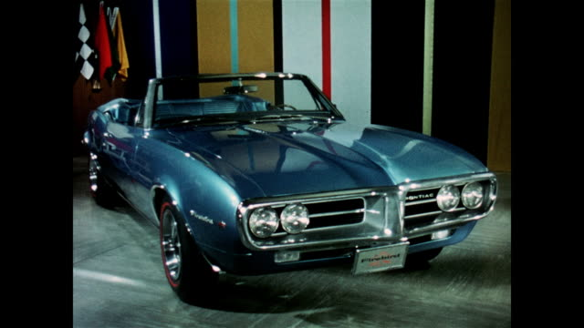 1967 pontiac firebird: a turn-on for customers - blue convertible stock videos & royalty-free footage