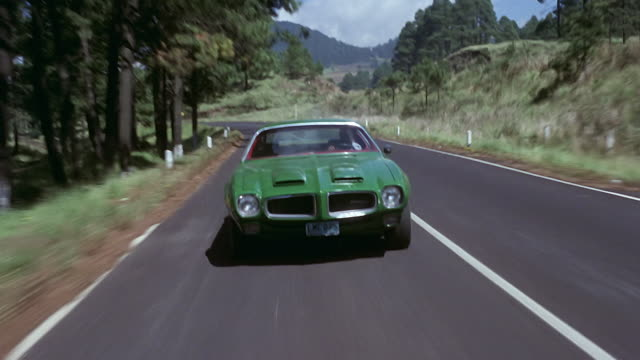 pontiac firebird speeding through countryside road and then takes dirt road - point of view stock videos & royalty-free footage