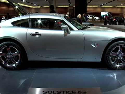 pontiac solstice coupe driver side profile / floor sign; to passenger side profile / steering wheel and dashboard; narrator can be heard talking... - three quarter length stock videos & royalty-free footage