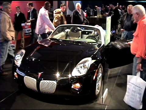 ws pontiac solstice front end / ws rear end of car 2006 pontiac solstice montage at cobo hall on january 19 2006 in detroit michigan - curious cumulus productions stock videos and b-roll footage
