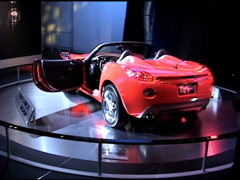ws pontiac solstice gxp sports car revolving on turntable 2007 pontiac solstice gxp at cobo hall on january 19 2006 in detroit michigan - pontiac stock videos and b-roll footage