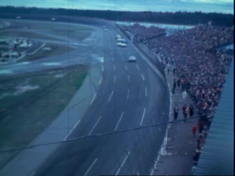 Pontiac stock car parked in starting column during rain delay Daytona 500 Daytona International Speedway / stock cars including 1963 Ford racing /...