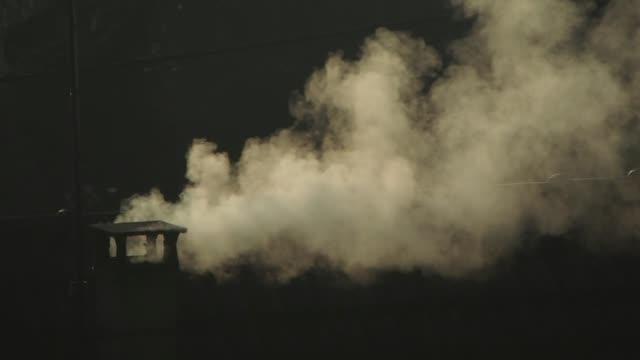 vidéos et rushes de pontoise france smoking chimney the heating smoke of a house on december 10 2019 in pontoise france - bruno levesque
