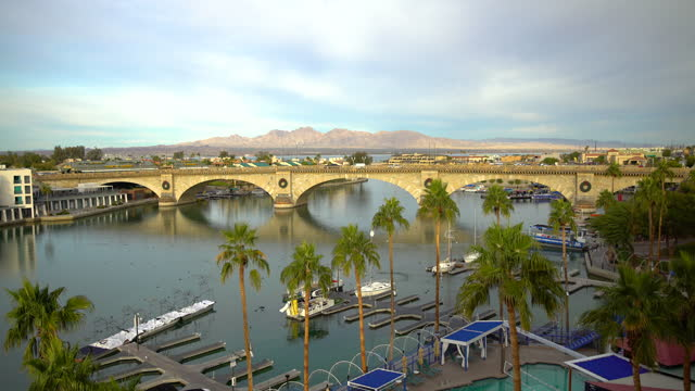 pontoon harbor and london bridge lake havasu arizona - bridge built structure stock videos & royalty-free footage