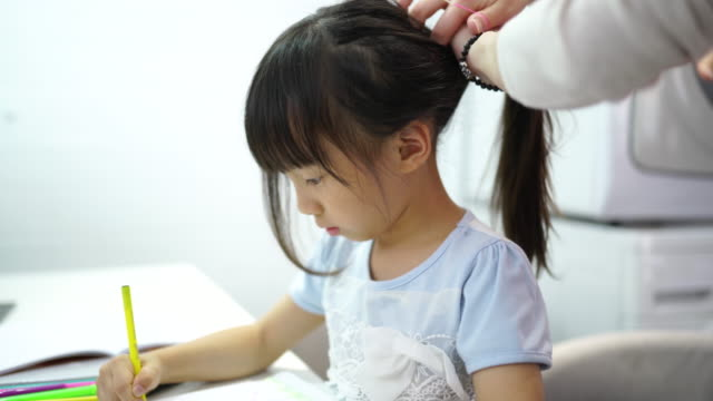 ponytail for mommy's creative little girl - pen isolated stock videos & royalty-free footage