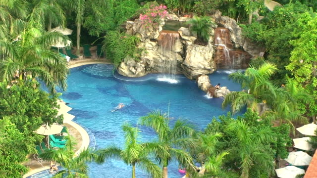 pool at a luxury resort and spa - patio stock videos & royalty-free footage