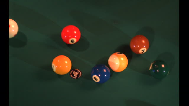 pool balls scatter as the cue ball hits them on an opening break. - cue ball stock videos & royalty-free footage
