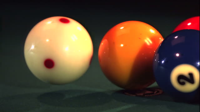 pool balls scatter as the rack is being broken by the cue ball. - cue ball stock videos & royalty-free footage