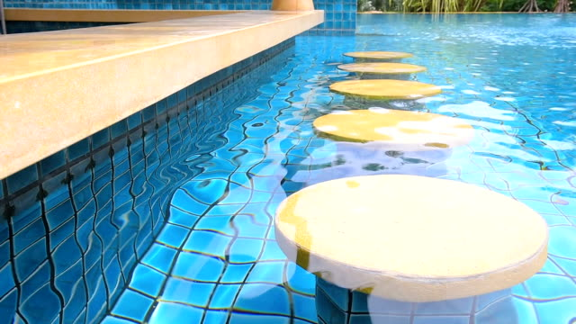 pool bar seat at swimming pool with ripple water
