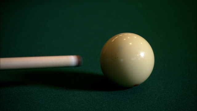 a pool cue strikes a cue ball. - cue ball stock videos & royalty-free footage