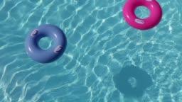 Pool hoops floating in water