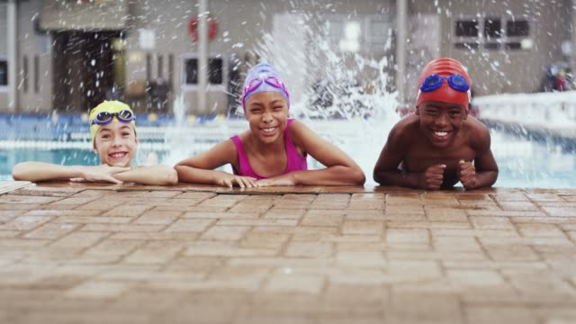 pool kids are cool kids - swimming costume stock videos and b-roll footage