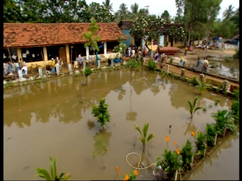a pool of sea water and raw sewage fills the playground of a primary school used as a refugee camp following the 2004 indian ocean tsunami - 2004 stock videos & royalty-free footage