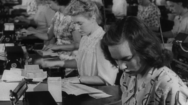 1950 montage pool of typists and data entry clerks working at their machines / united kingdom - typing stock videos & royalty-free footage