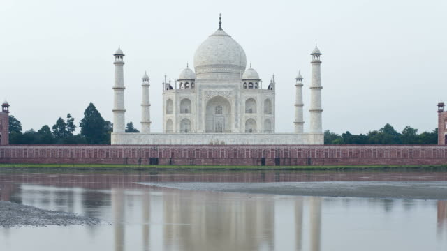 a pool reflects the taj mahal in agra. - agra stock videos and b-roll footage