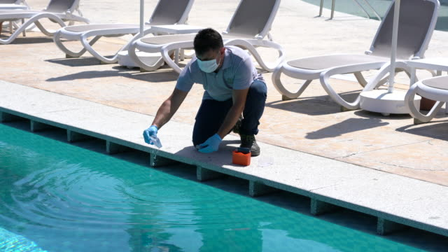 pool testing kit being used in a swimming pool - cleaner stock videos & royalty-free footage
