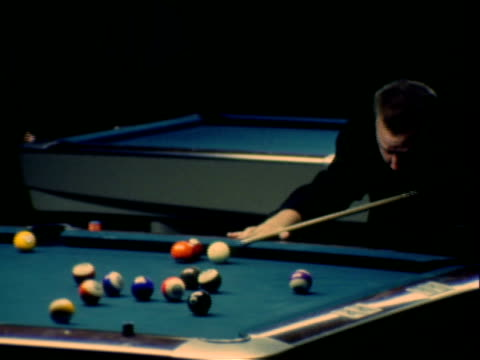 pool tournament billiard balls being hit on pool table rolling into pockets / cue ball being struck knocking striped ball into side pocket / trick... - cue ball stock videos & royalty-free footage