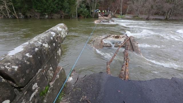 pooley bridge destroyed by storm desmond, lake district, uk. - bridge built structure stock videos & royalty-free footage