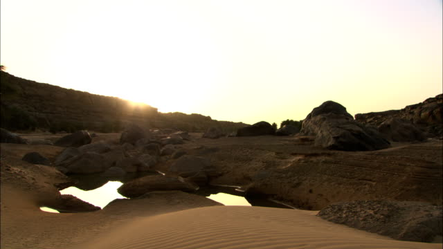 pools of water reflect sunlight. - mauritania stock videos & royalty-free footage