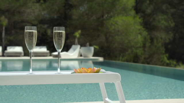 poolside champagne (jib up) - swimming pool stock videos & royalty-free footage