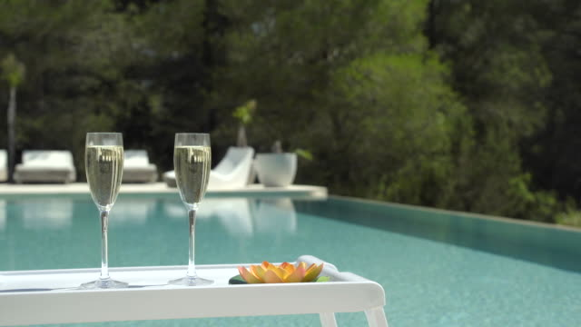 poolside champagne (jib down) - outdoor chair stock videos & royalty-free footage