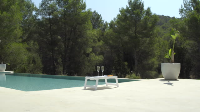 poolside champagne (wide) - poolside stock videos & royalty-free footage
