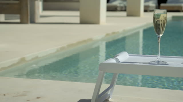 poolside champagne (close up) - poolside stock videos & royalty-free footage