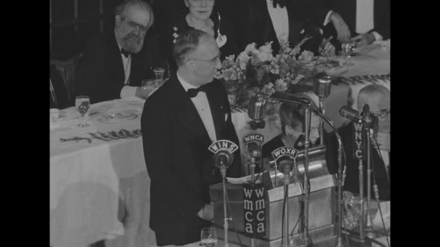 [poor audio throughout] sot wilhelm morgenstierne, norwegian ambassador to the us, speaks at lectern with microphones of wins, wmca, woxr, wnyc as he... - award stock-videos und b-roll-filmmaterial