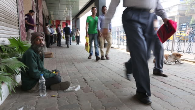 a poor beggar on the streets of calcutta, bengal,  - kolkata stock videos & royalty-free footage