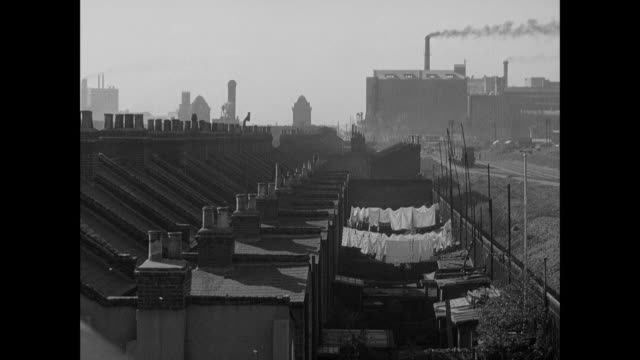 montage poor british civilians rent rooms in dilapidated homes in the smoke and grime of the city's slums / london, england, united kingdom - slum stock-videos und b-roll-filmmaterial