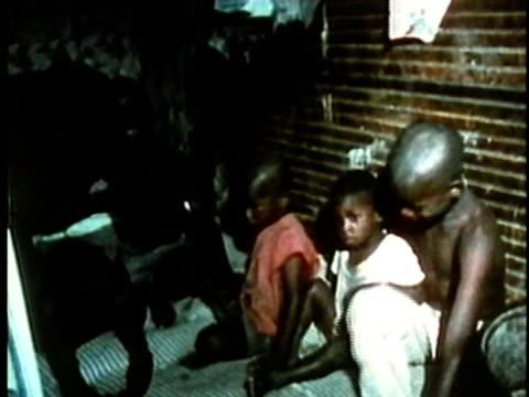stockvideo's en b-roll-footage met poor children in run-down house/ usa/ audio - zij aan zij
