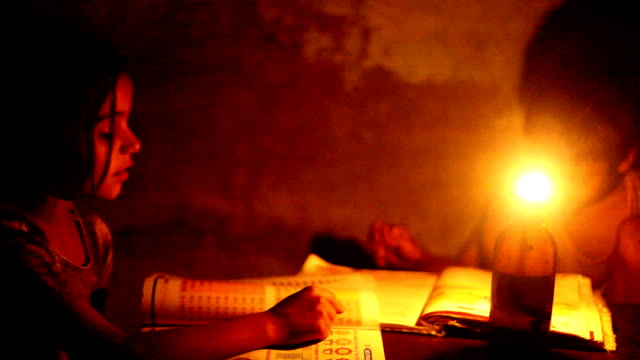 poor children reading under lantern light - oil lamp stock videos & royalty-free footage