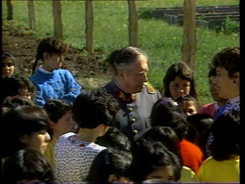 Poor health to prevent extradition LIB CHILE EXT Children surrounding General Augusto Pinochet PAN ZOOM IN Pinochet surrounded by children PULL...