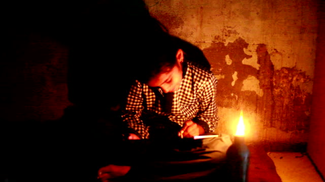 poor little girl studying at home with lantern - oil lamp stock videos & royalty-free footage
