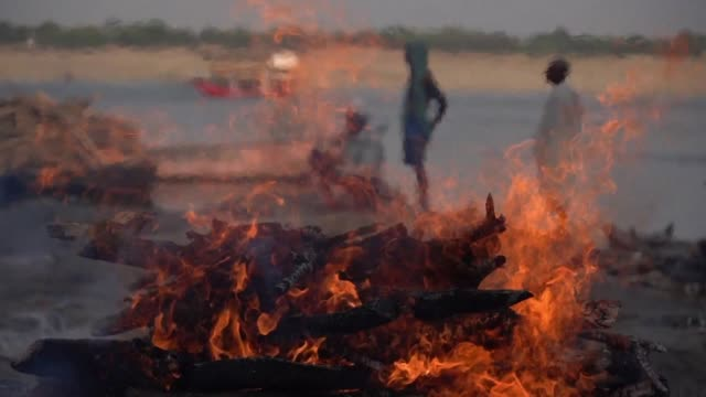 poor low caste community known as doms have for generations been caretakers of the funeral fires in varanasi one of india's holiest cities where... - funeral stock videos & royalty-free footage