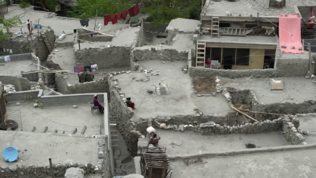 a poor neighbourhood in the town of karimabad, hunza valley, pakistan - pakistan stock videos & royalty-free footage