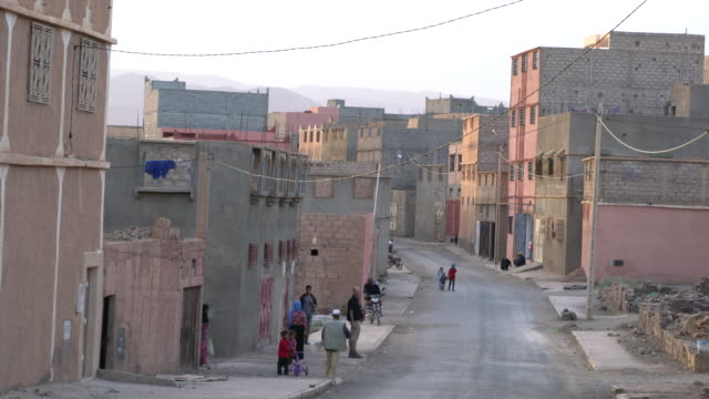 a poor street and neighborhood in the town of agdz, saharan morocco - town stock videos & royalty-free footage