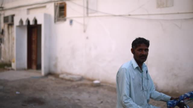 poor working class man - dubai - maintenance worker stock videos & royalty-free footage