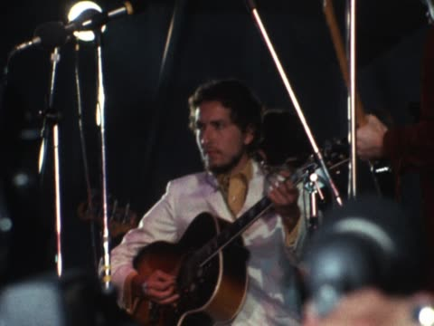 pop band the beatles watching singer bob dylan performing on stage at the isle of wight music festival - isle of wight stock videos & royalty-free footage