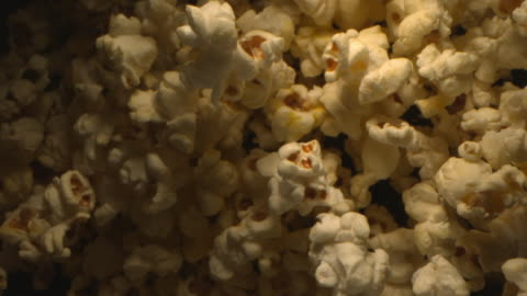 pop corn is tossed in the air in slow motion - popcorn stock videos & royalty-free footage