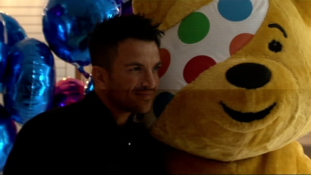 'pop goes the musical' photocall and interviews england london photography *** pudsey bear at photocall for 'pop goes the musical' event / peter... - photo call stock videos & royalty-free footage