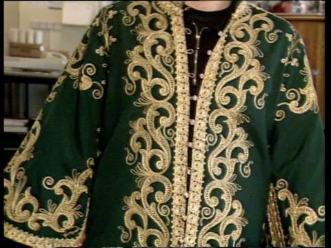 pop memorabilia auction tcms elvis presley's goldembroidered green dressing gown modelled tilt upcms elvis' blue pyjama jacket on... - leather jacket stock videos and b-roll footage
