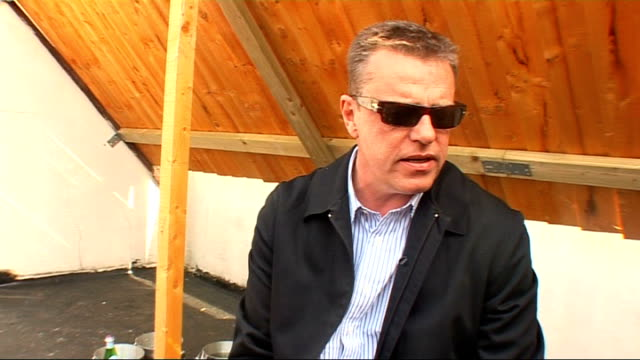 camden crawl' weekend; int unidentified man with guitar performing song on small stage in bar / cafe sot ext suggs interview sot int unidentified... - suggs musician stock videos & royalty-free footage