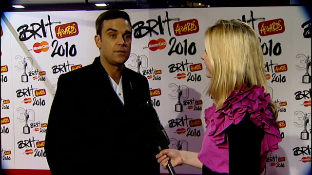 2010 Brit Awards ENGLAND London Earl's Court Brit Awards INT Robbie Williams interview SOT discusses his 'Outstanding Contribution to Music' award