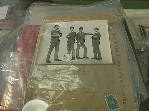 auction of beatles memorabilia bnaf england london auction catalogue in hand of man in audience pull out london and tilt up sotheby's tcms beatles... - film tilt stock videos & royalty-free footage