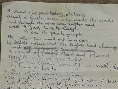 auction of beatles memorabilia; ** sound overlay: the beatles songs ** england: london: int tcms handwritten sheet with words to the beatles song... - part of a series stock videos & royalty-free footage