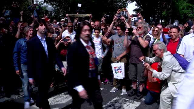 beatles fans flock to abbey road to mark 50th anniversary of album's cover photograph england london abbey road ext various of the beatles lookalikes... - doppelgänger stock-videos und b-roll-filmmaterial