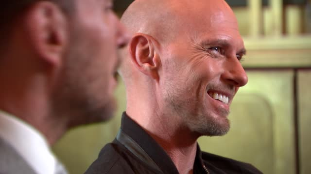 bros documentary nominated for three awards at bafta television awards; england: london: int luke goss and matt goss interview sot - re documentary... - documentary film stock videos & royalty-free footage