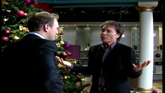 cliff richard aims for chrismas number 1 england london int sir cliff richard stands talking with reporter in television studio standing next to... - cliff richard stock videos and b-roll footage