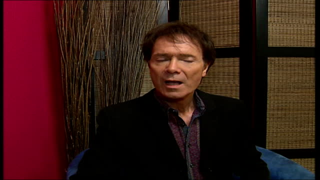 cliff richard aims for chrismas number 1; sir cliff richard interview sot - gave tony blair a copy of new single - cliff richard stock videos & royalty-free footage